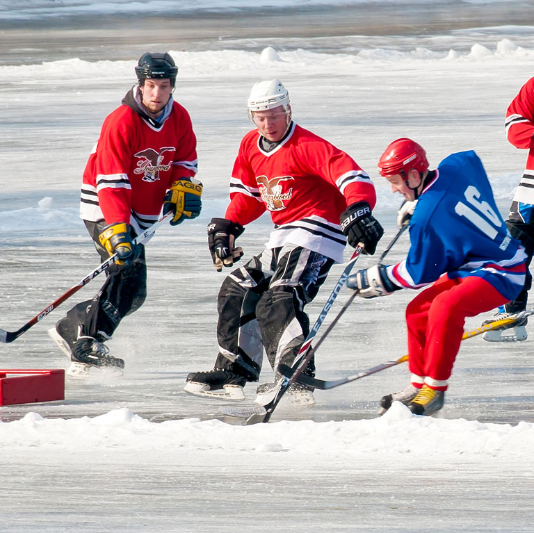 Pond Hockey Players fighting for the puck